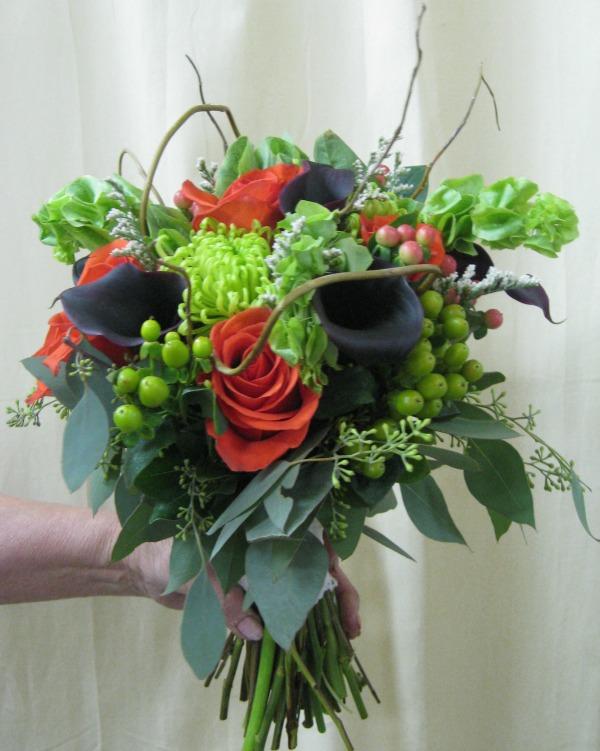 Orange rose and green spider bouquet