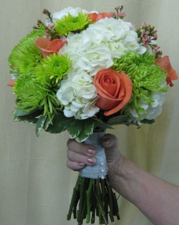 white hydrangea with coral and green